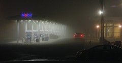 Mobil in the mist at one of the rest stops on the Connecticut Turnpike (I-95). It was like this all the way home to New York from a trip to visit old friends in West Haven. Not a fun ride at 15 miles per hour and near-zero visibility! Jan 2017 (wavz13) Tags: connecticutphotographs connecticutphotos connecticutphotography gasstations fog mysterious noire impressionist surreal highways highwayreststops highwaygasstations moody edwardhopper hopperesque newengland painterly mystical odd enigmatic cryptic curious spiritual secretive cars transcendental surrealistic unusual dreamlike bizarre dreamy unreal weird mist misty pointilism murky fuzzy nebulous indistinct blurry blurred clouded cloudy vapors vaporous trucks pickuptrucks connecticuthighways creepy eerie gasoline fillingstations atmosphere atmospheric