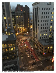 One Street in San Francisco as Evening Approaches (Doyle Wesley Walls) Tags: lagniappe 3505 street cars automobilies buildings traffic kearny lights city iphonephoto sanfrancisco doylewesleywalls photograph