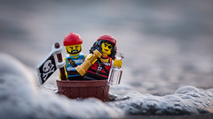 The Pirates are coming! (alternate) (Reiterlied) Tags: beach boat flag japan jolly lego minifig minifigure outdoor pirate roger sea sunset tokyo toy water wave
