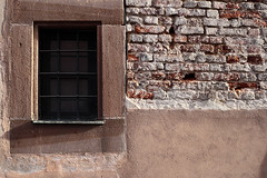 Better to sit than to stand (airSnapshooter) Tags: window wall brick shadow red trellis nurnberg germany deutschland