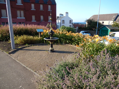 Flowerbed and statue in Dunbar