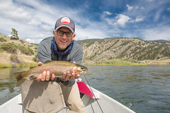 Big Fat Rainbow (Rudy Malmquist) Tags: fish man male smile creek river boat rainbow fishing wolf montana sunny rudy missouri flyfishing guide trout drift angler malmquist outfitter