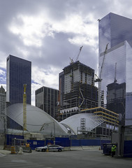 Architectural Structure In World Trade Center Area (Modern Architecture, Ongoing Construction Taking Place) (nrhodesphotos(the_eye_of_the_moment)) Tags: auto nyc rooftop geometric glass lines metal architecture reflections shadows crane manhattan steel worldtradecenter curves shapes financialdistrict woodenfence westside constructionsite pathtrain moderndesign securityman wwwflickrcomphotostheeyeofthemoment theyeofthemoment21gmailcom dsc05440200