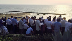 Group of prayers (Dan_lazar) Tags: sunset woman sun holiday beach water religious book israel group jews  rosh hashana       tashlich     neyanya