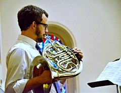 French horn player accompanies the choir