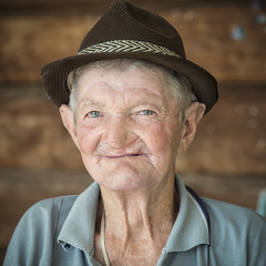 At the pub, Maramures, Romania (Brave Lemming) Tags: life old travel portrait man smile face hat rural europe village happiness squareformat simplicity romania easterneurope romanian maramures