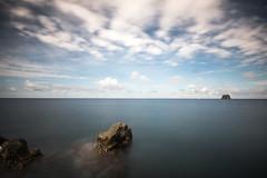 Stromboli 12 (gsamie) Tags: 600d aeolianislands canon guillaumesamie isoleeolie italy rebelt3i sicilia sicily stromboli vulcano beach blue clouds gsamie longexposure sea strombolicchio volcano wideangle