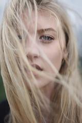 Summer Storms (Ella Ruth) Tags: portrait woman girl blonde longhair windinhair windy windswept windblown blueeyes messyhair storms stormy dramaticweather closeup cheekbones greysky summer heat nikon d750 50mm 14 photographer shrewsbury shropshire leicester ellaruth