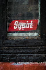 Squirt 2 (CarusoPhoto) Tags: john caruso carusophoto pentax ks2 squirt brick wall black red natural light beautiful banal mundane ordinary everyday hd pentaxda l 1850mm f456 dc wr re hdpentaxdal1850mmf456dcwrre chicago city urban abandoned closed old vintage retro