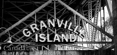 Granville Island Sign B&W - Vancouver, Canada (The Web Ninja) Tags: vancouver yvr travel vancity canon canon70d 70d photo photography photograph bc british columbia canada canadian explore explorebc explored granville granvilleisland sign signage black white bw blackwhite false creek falsecreek harbour harbor architecture