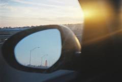 Nebraska Capitol in my rear view mirror (tylerfernandez) Tags: lomography konstructor 35mm lincoln nebraska film car mirror midwest usa kodak heartland sunset behind reflection reflect reflects reflected