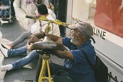 Oldman and bike (gustavo gpg) Tags: street film bike yellow azul 35mm oldman 40mm canonet