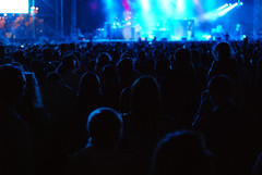 Crowd at a Concert (Themeisle) Tags: crowd concert blue light public audience entertainment silhouette song stage