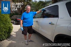 Phillips McDowell points at where the water had reached on his car when the flood came in South Carolina.
