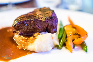 Filet mignon with veal stock balsamic reduction, mixed peppers, green beans
