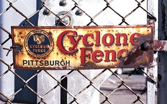 Cyclone Fence explored (rentavet) Tags: fence rusty ussteel 50mmf18 nikonfg fuji200asa wovenwirefence americansteelandwiredivision
