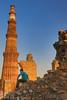 Man Sitting in Front of Qutub Minar (taharaja) Tags: agra agrafort babytaj bazaar delhi delhimasjid fatehpursikri india indiagate jamimasjid minaret olddelhi oldmarket qutubminar redfort tajmahal tower
