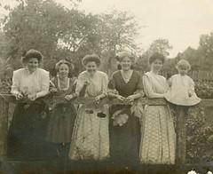Girls with grapes in a garden (sctatepdx) Tags: snapshot oldsnapshot vintagesnapshot vernacular vintageclothes vintagedresses realphotopostcard rppc