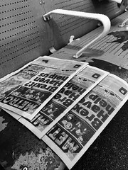 Day 16. Soggy start to the week. (Rob Emes) Tags: black bw mono london iphone iphoneography iphone6 drops seat rain wet soggy newspaper newspapers news