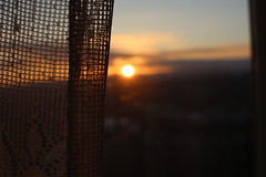 Sunset. (h_a_p) Tags: sunset sun blury window look landscape outside curtain orange afternoon focus