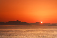 Hazy sunrise over Turkey (tollen) Tags: ocean sunset sun mountains june sunrise turkey rays trkye turkeyinbackground