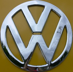 '56 Deluxe Emblem (jessicafm) Tags: auto bus car yellow vw emblem volkswagen logo symbol deluxe chrome squaredcircle squircle 1956 van rare