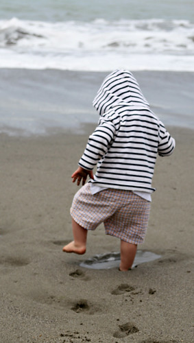 boy making footprints on the beach