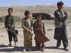 Boys in front of an old tank near Bamyan in Afghanistan (MastaBaba) Tags: boy afghanistan boys kids children kid asia tank buddha small afghan buddhas bamyan 20050805 saarc 20060630