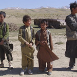 Boys in front of an old tank near Bamyan in Afghanistan