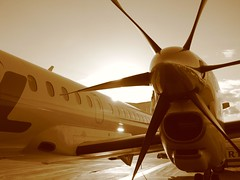 Propeller (karinga) Tags: trip windows sky travelling tag3 taggedout sepia plane wow airplane flying airport tag2 tag1 wing propeller helsinkivantaa flylal