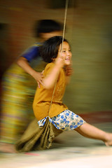 pushing swing - nepal children kids asia kathmandu swing play girls 2002 game playing helping
