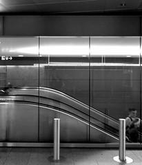 in motion (perldude) Tags: people urban blackandwhite motion reflection blackwhite escalator selection hannover centralstation