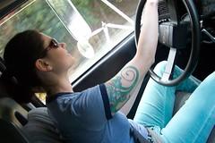 Trucker (miss.love) Tags: woman me sunglasses smiling tattoo skinny moving rachel driving arms legs trucker cab tattoos ear earrings uhaul thin steeringwheel seatbelt longlegs movingtruck truckdriver movingvan californiatooregon truckerhottie truckerbabe femaletruckdriver