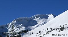 Steven's Peak - Winter (Mindy Schreven) Tags: trees sky white mountain snow tree landscape hill peaceful peak hills mountians snowcap cornus