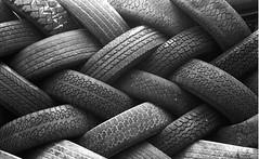 Braided (whiteoakart) Tags: blackandwhite black junk michigan detroit stack tires stacking braid