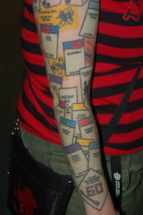 Comic Con 2006: Monopoly Tattoo (earthdog) Tags: 2006 sandiego summervacation06 monopoly tattoo comiccon comicbookcon needstags word game gamepiece arm armtattoo comiccon06 510fav unknownperson unknownartist bodyart needscamera needslens vacation travel