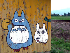 random fukumitsu 5 (highglosshighs) Tags: blue white yellow japan fun drive random character painted exploring sunday july 2006 randomness busshelter totoro miyazaki  ghibli toyama neighbour fukumitsu
