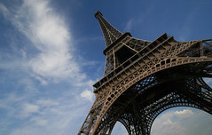 Eiffel vs. The Sky (Toni Blay) Tags: voyage trip light sunset sky holiday paris france topf25 clouds interestingness eiffeltower wideangle eiffel panoramic toureiffel torreeiffel pixies 30d 10mm famousbuilding