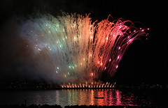 Rainbow in Fireworks Vancouver (ahisgett) Tags: world sea canada reflection english water colors vancouver reflections bay championship rainbow colours fireworks multicoloured festivaloflight englishbay ubuntu hsbc celebrationoflight hisgett anawesomeshot