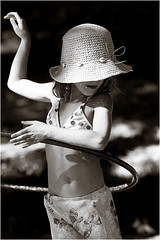 hula girl (Sara Heinrichs (awfulsara)) Tags: bw girl hat child candid hula grace hulahoop
