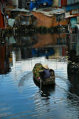 Slum on the Water (J Catlett) Tags: reflection digital asian photography boat canal nikon asia seasia southeastasia vietnam d200 nikkor saigon hochiminhcity hcmc indochina worldnomads 90points seasian nhiulc