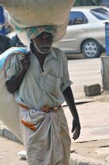 Street 0003 (eternal_ag0ny) Tags: road street light india man car walking photography nikon day shot candid bangalore nikkor 18200mm d300s