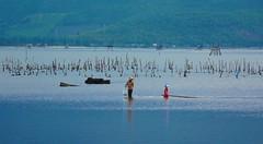 Lagoon Fishing (free3yourmind) Tags: blue men fishing child lagoon vietnam waters fishingnet langco