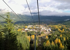 Golden autumn light in Whistler (Ruth and Dave) Tags: autumn trees sky green fall weather yellow clouds whistler colours village lift resort cables gondola weatherphotography whistlervillagegondola
