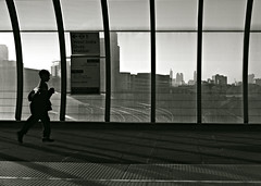 The City is your Playground (Becky Frances) Tags: city uk boy england urban blackandwhite london silhouette candid streetphotography olympus docklands dlr socialdocumentary cityoflondon eastlondon 2015 lensblr beckyfrances