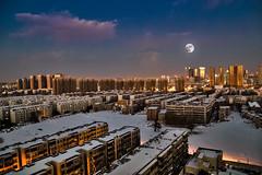 Moonlit Zhengzhou (damien_thorne) Tags: city winter cloud moon snow building weather skyline landscape cityscape dusk clear zhengzhou