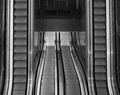 Escalator (moniekvanrijbroek) Tags: street city urban blackandwhite white black monochrome architecture modern escalator indoor panasonic indoors movingstaircase g7