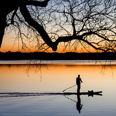 lonesome ... (ewaldmario) Tags: blue sunset orange lake reflection tree water silhouette germany square bayern bavaria boot see boat nikon wasser europe mood colours sonnenuntergang blau lightening spiegelung sundowner wrthsee paddler sonnenuntergant ewaldmario