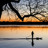 lonesome ... (ewaldmario) Tags: blue sunset orange lake reflection tree water silhouette germany square bayern bavaria boot see boat nikon wasser europe mood colours sonnenuntergang blau lightening spiegelung sundowner wörthsee paddler sonnenuntergant ewaldmario