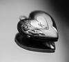 Reflected Locket  *Explore* (John Kocijanski) Tags: macromondays macro redux redux2016myfavoritethemeoftheyear heart jewelry locket mirror reflection bokeh canon60mmusmmacrolens